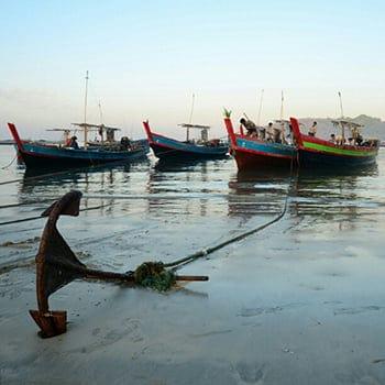 boat anchoring at shore
