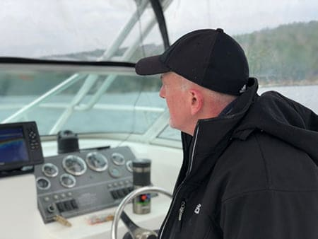 captain driving the fishing boat