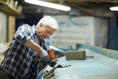man repairing the boat