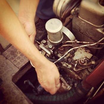 man repairing the motor
