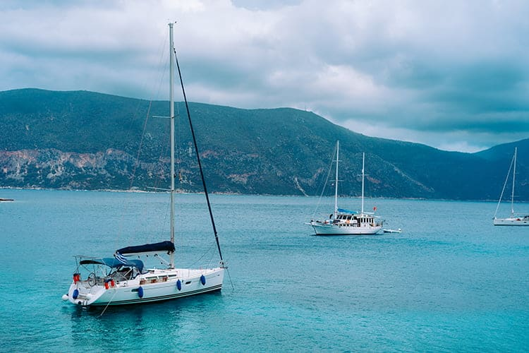 yachts anchored near shoreline