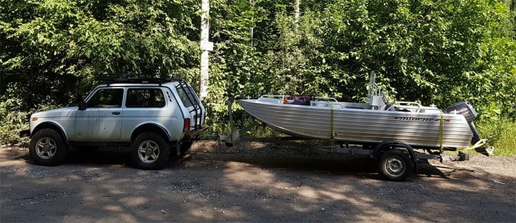 car carries motorboat on a trailer